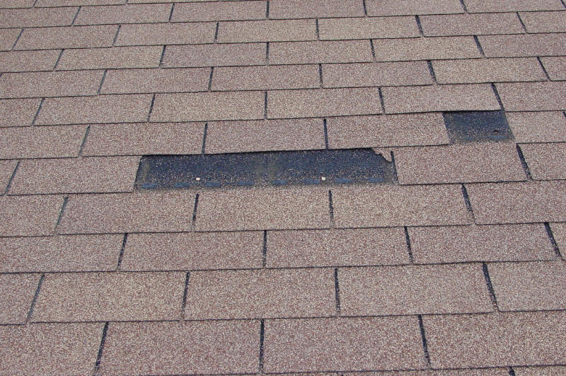 roofing contractor repair torn shingle missing shingle
